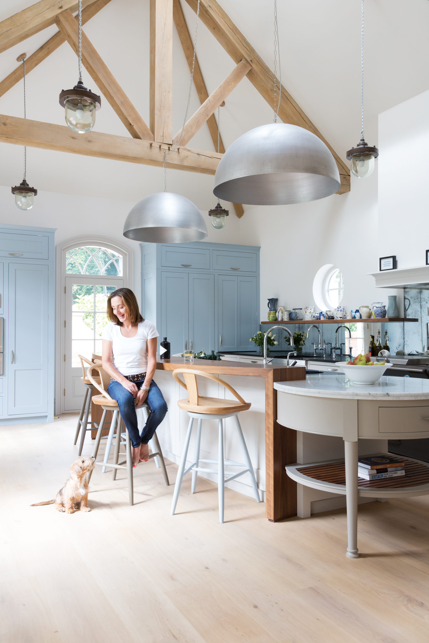Paul Craig Interior Photographer, People Photography, Lady and dog in Kitchen