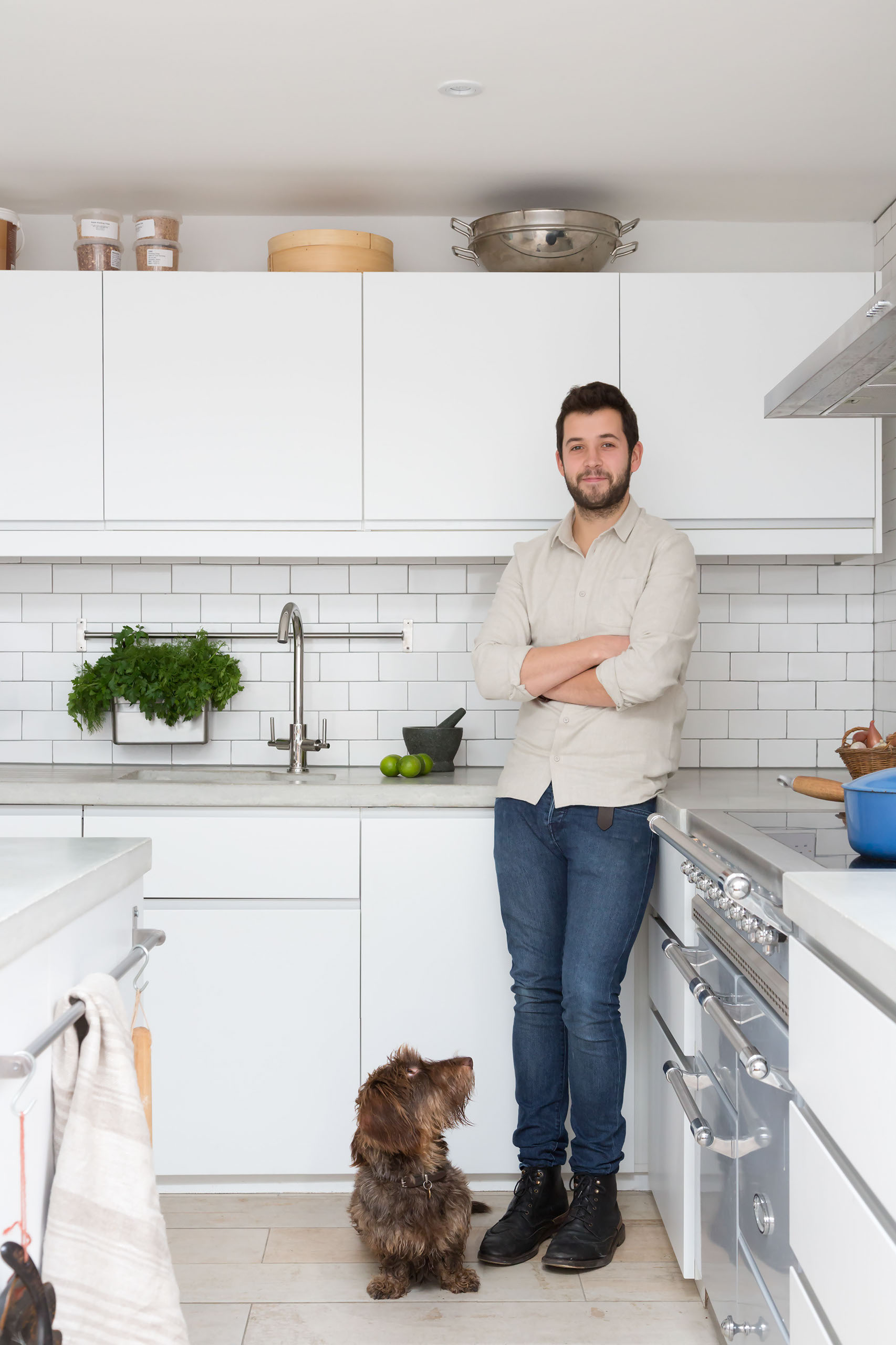 Paul Craig Interior Photographer London, People Photography, Chef and dog in kitchen
